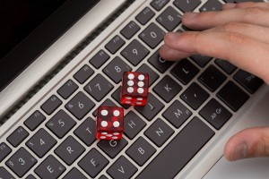 9808111-red-game-dices-on-laptop